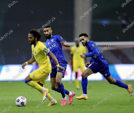 Al-Hilal's players Mohammed Al-Burayk (R) and Salman Al-Faraj (C) in action against Al-Nassr's Abdulmajeed Al-Sulaiheem (L) during the Saudi King's Cup final soccer match between Al-Hilal and Al-Nassr at King Fahd International Stadium, in Riyadh, Saudi Arabia, 28 November 2020.