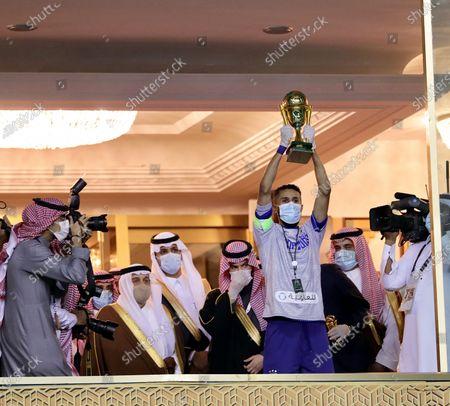 Al-Hilal's captain Salman Al-Faraj (R) lifts the trophy after winning the Saudi King's Cup final soccer match between Al-Hilal and Al-Nassr, as Al-Hilal's club president Fahad Bin Nafal (2-R) and the governor of Riyadh Region, Faisal bin Bandar Al Saud (2-L), look on at King Fahd International Stadium, in Riyadh, Saudi Arabia, 28 November 2020.