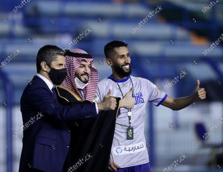 Al-Hilal's captain Salman Al-Faraj (R), Club president Fahad bin Nafil Alotaibi (C) and coach Razvan Lucescu (L) celebrate after winning the Saudi King's Cup final soccer match between Al-Hilal and Al-Nassr at King Fahd International Stadium, in Riyadh, Saudi Arabia, 28 November 2020.