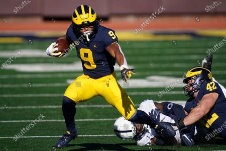 Michigan running back Chris Evans (9) runs during the first half of an NCAA college football game against Penn State, in Ann Arbor, Mich