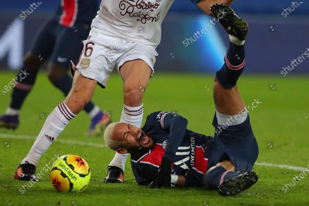PSG's Neymar falls as he challenges for the ball with Laurent Koscielny of Bordeaux, during their League One soccer match between Paris Saint Germain and Bordeaux, at the Parc des Princes stadium in Paris, France