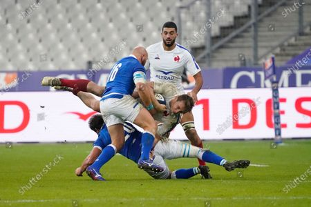 France vs Italy. Anthony Jelonch of France is tackled by Michele Lamaro of Italy and Leonardo Ghiraldini of Italy