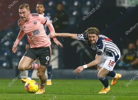 Stock Photo of Sheffield United's Oliver McBurnie, left, takes the ball away from West Bromwich Albion's Conor Gallagher during the English Premier League soccer match between West Bromwich Albion and Sheffield United at The Hawthorns in West Bromwich, England