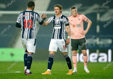 Stock Image of West Bromwich Albion's Conor Gallagher, centre, shakes hands with teammate Albion's Matt Phillips, left, following the English Premier League soccer match between West Bromwich Albion and Sheffield United at The Hawthorns in West Bromwich, England