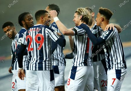 West Bromwich Albion's Conor Gallagher, centre, is congratulated by teammates after scoring his team's first goal during the English Premier League soccer match between West Bromwich Albion and Sheffield United at The Hawthorns in West Bromwich, England