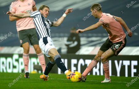 West Bromwich Albion's Conor Gallagher, left, and Sheffield United's Chris Basham compete for the ball during the English Premier League soccer match between West Bromwich Albion and Sheffield United at The Hawthorns in West Bromwich, England