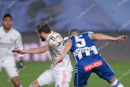 Stock Image of Real Madrid's Jose Ignacio Fernandez Iglesias, left, vies for the ball with Alaves' Victor Laguardia as he wins a penalty kick during the Spanish La Liga soccer match between Real Madrid and Alaves at Alfredo di Stefano stadium in Madrid, Spain