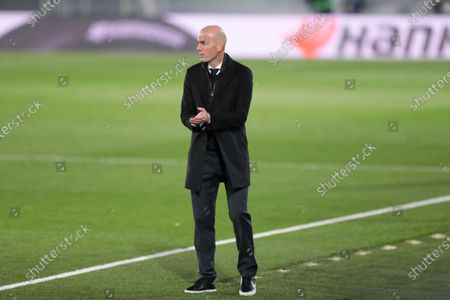 Real Madrid's head coach Zinedine Zidane applauds to his players during the Spanish La Liga soccer match between Real Madrid and Alaves at Alfredo di Stefano stadium in Madrid, Spain