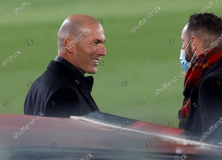 Real Madrid's head coach Zinedine Zidane (L) greets Alaves' head coach Pablo Machin (R) prior to the Spanish LaLiga soccer match between Real Madrid and Deportivo Alaves held at Alfredo Di Stefano stadium in Madrid, central Spain, 28 November 2020.