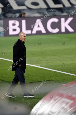 Real Madrid's head coach Zinedine Zidane reacts during the Spanish LaLiga soccer match between Real Madrid and Deportivo Alaves held at Alfredo Di Stefano stadium in Madrid, central Spain, 28 November 2020.