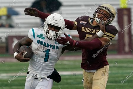 Coastal Carolina's CJ Marable (1) runs past Texas State's Kevin Anderson (5) during the first half of an NCAA college football game in Austin, Texas