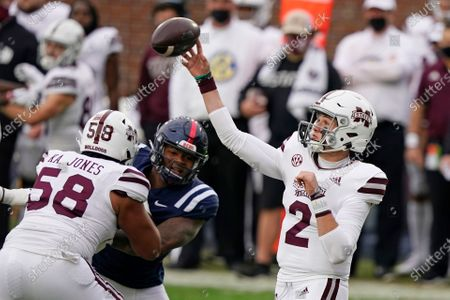 Mississippi State quarterback Will Rogers (2) passes while Kameron Jones (58) blocks a Mississippi player during the first half of an NCAA college football game, in Oxford, Miss