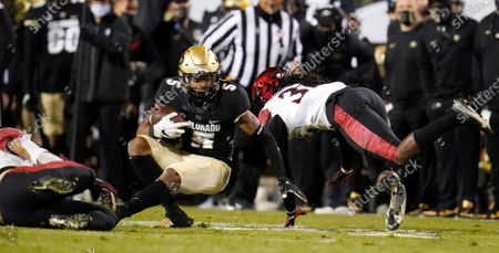 Stock Picture of Colorado wide receiver La'Vontae Shenault, center, is stopped after catching a pass by San Diego State linebacker Michael Shawcroft, left, and safety Dwayne Johnson Jr. in the second half of an NCAA college football game, in Boulder, Colo
