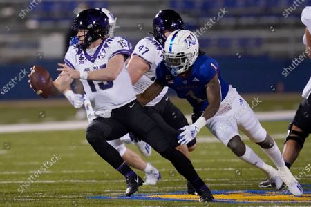 Quarterback Max Duggan (15) scrambles away from Kansas safety Kenny Logan Jr. (1) during the first half of an NCAA college football game in Lawrence, Kan