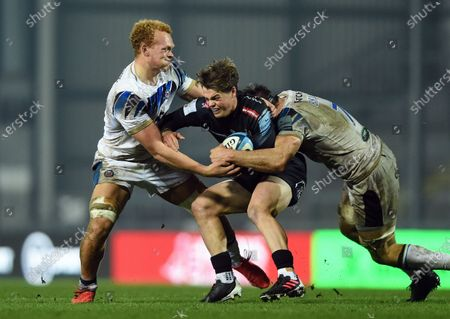 Stock Image of Jack Walsh of Exeter Chiefs is double-tackled by Miles Reid and Josh Bayliss of Bath Rugby