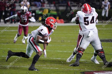 Georgia running back James Cook (4) carries the ball during the first half of the team's NCAA college football game against South Carolina, in Columbia, S.C