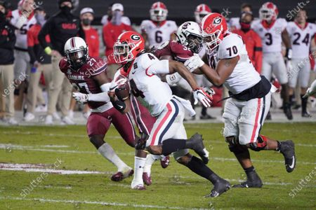 Georgia running back James Cook (4) carries the ball for a touchdown during the first half of the team's NCAA college football game against South Carolina, in Columbia, S.C