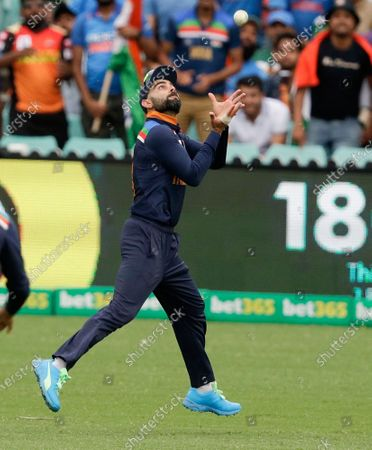 India's Virat Kohli takes a catch to dismiss Australia's Aaron Finch during the one day international cricket match between India and Australia at the Sydney Cricket Ground in Sydney, Australia