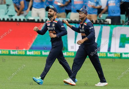 India's Virat Kohli, left, is congratulated by teammate Mayank Agarwal after taking a catch to dismiss Australia's Aaron Finch during the one day international cricket match between India and Australia at the Sydney Cricket Ground in Sydney, Australia