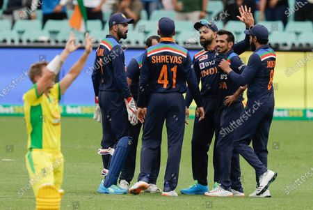 Stock Image of India's Virat Kohli, third right, is congratulated by teammates after dismissing Australia's Aaron Finch during the one day international cricket match between India and Australia at the Sydney Cricket Ground in Sydney, Australia