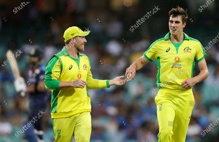 Stock Picture of Australia's captain Aaron Finch, left, talks with Australia's Pat Cummins during the one day international cricket match between India and Australia at the Sydney Cricket Ground in Sydney, Australia