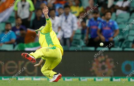 Stock Photo of Australia's Aaron Finch falls as he fails to take a catch during the one day international cricket match between India and Australia at the Sydney Cricket Ground in Sydney, Australia