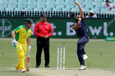 India's Mohammed Shami bowls as Australia's Aaron Finch watches during the one day international cricket match between India and Australia at the Sydney Cricket Ground in Sydney, Australia