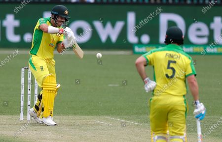 Australia's David Warner bats as partner Aaron Finch watches during the one day international cricket match between India and Australia at the Sydney Cricket Ground in Sydney, Australia