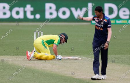 Australia's Aaron Finch reacts as he is hit from adelivery from India's Navdeep Saini, right, while batting during the one day international cricket match between India and Australia at the Sydney Cricket Ground in Sydney, Australia