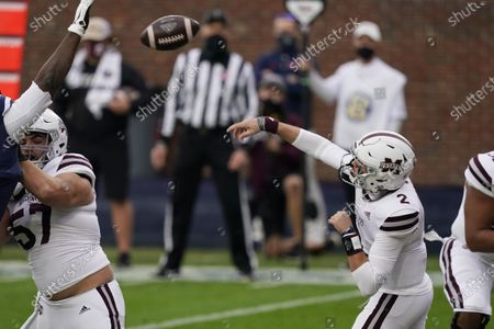 Mississippi State quarterback Will Rogers (2) passes while Mississippi State offensive lineman Cole Smith (57) blocks a Mississippi defensive lineman during the first half of an NCAA college football game, in Oxford, Miss. Mississippi won 31-24