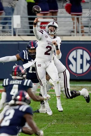 Under pressure from Mississippi defenders, Mississippi State quarterback Will Rogers (2) passes downfield during the second half of an NCAA college football game, in Oxford, Miss. Mississippi won 31-24
