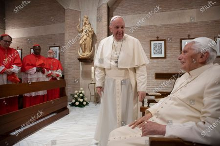 Stock Picture of Pope Francis hold hands with Pope Emeritus Pope Benedict XVI