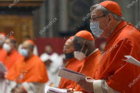 Cardinal George Pell, right, attends a Mass celebrated by Pope Francis the day after the pontiff raised 13 new cardinals to the highest rank in the Catholic hierarchy, at St. Peter's Basilica