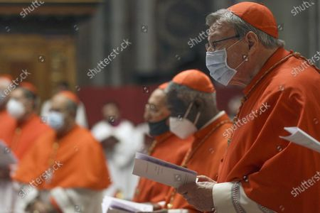 Australian Cardinal George Pell (R) attends a Mass celebrated by Pope Francis the day after a Consistory where he raised 13 new cardinals to the highest rank in the Catholic hierarchy, at St. Peter's Basilica, Vatican City, 29 November 2020.