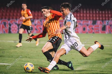 Juventus' Paulo Dybala (R) vies with Benevento's Federico Barba during a Serie A soccer match between Benevento and Fc Juventus in Benevento, Italy, Nov. 28, 2020.
