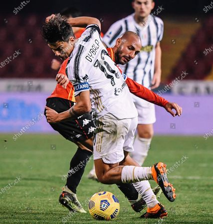 Stock Picture of Juventus' Paulo Dybala (L) vies with Benevento's Pasquale Schiattarella during a Serie A soccer match between Benevento and Fc Juventus in Benevento, Italy, Nov. 28, 2020.