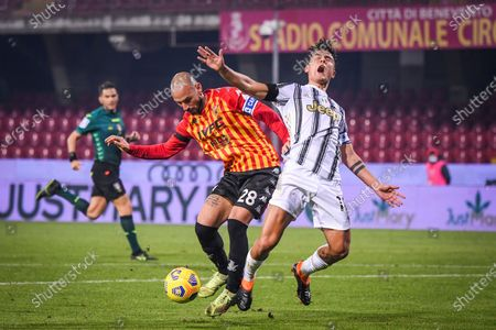 Stock Photo of Juventus' Paulo Dybala (R) vies with Benevento's Pasquale Schiattarella during a Serie A soccer match between Benevento and Fc Juventus in Benevento, Italy, Nov. 28, 2020.