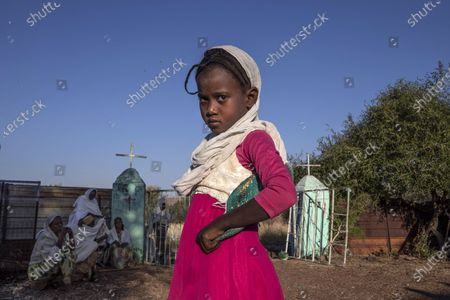 Tigrayan girl who fled the conflict in Ethiopia's Tigray region, prepares to leave after Sunday Mass ends at a church, near Umm Rakouba refugee camp in Qadarif, eastern Sudan