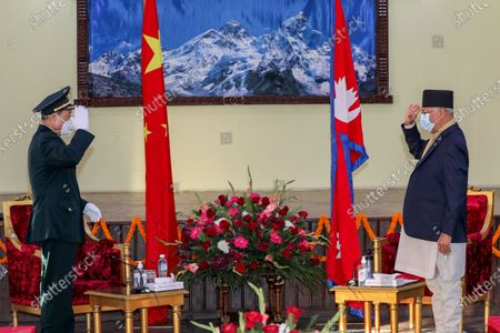 A handout photo made available by Nepalese Prime Minister's Private Secretariat shows Nepalese Prime Minister K. P. Sharma Oli (R) meets with Chinese Defence Minister Wei Fenghe (L) at the Prime Minister's official residence in Kathmandu, Nepal, 29 November 2020. The State Councilor and Defense Minister of China arrived for a one day official visit.