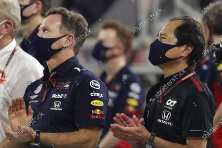 Christian Horner, Team Principal, Red Bull Racing, and Toyoharu Tanabe, F1 Technical Director, Honda, applaud their drivers on the podium during the 2020 Formula One Bahrain Grand Prix