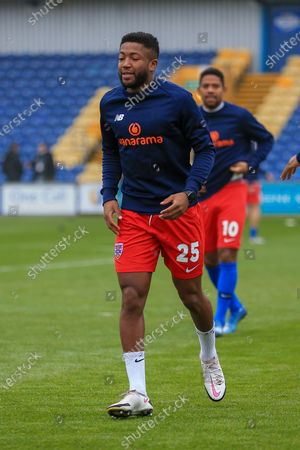 Scott Wilson (25) of Dagenham & Redbridge in the warm up during the The FA Cup match between Mansfield Town and Dagenham and Redbridge at the One Call Stadium, Mansfield