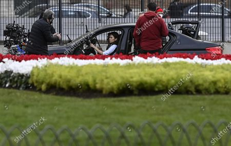 Christopher McQuarrie (L) with US actor Tom Cruise (hidden) and British actress Hayley Atwell (C) talk during the shooting of Mission Impossible 7 at Piazza Venezia in Rome, Italy, 29 November 2020.