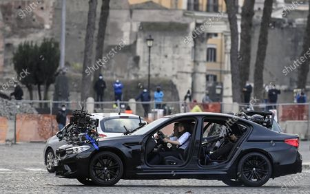 Tom Cruise (L) with British actress Hayley Atwell (R) sit in a car during the shooting of Mission Impossible 7 at Piazza Venezia in Rome, Italy, 29 November 2020.