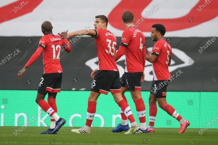 Southampton's Jan Bednarek, 2nd left, celebrates after scoring his side's opening goal during an English Premier League soccer match between Southampton and Manchester United at the St. Mary's stadium in Southampton, England