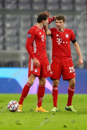 Bayern's Thomas Mueller, right, and team mate Leon Goretzka celebrate after during the Champions League Group A soccer match between Bayern Munich and RB Salzburg at the Allianz Arena in Munich, Germany