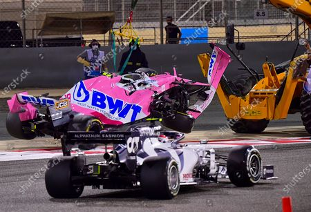 French Formula One driver Pierre Gasly of Scuderia AlphaTauri Honda passes near the Canadian Formula One driver Lance Stroll of BWT Racing Point crashing car during the Formula One Grand of Bahrain on the Bahrain International Circuit in Sakhir, Bahrain 29 November 2020.