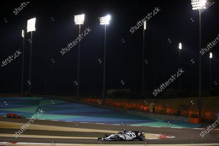 French Formula One driver Pierre Gasly of Scuderia AlphaTauri Honda (R) and Monaco's Formula One driver Charles Leclerc of Scuderia Ferrari (L) in action during the 2020 Formula One  Grand Prix of Bahrain at Bahrain International Circuit near Manama, Bahrain, 29 November 2020.