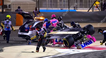 Racing Point's Canadian driver Lance Stroll (C) was helped into the medical car after crashing during the Formula One Grand of Bahrain on the Bahrain International Circuit in Sakhir, Bahrain 29 November 2020.
