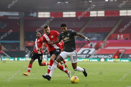 Jan Bednarek (L) of Southampton in action Marcus Rashford (R) of Manchester United during the English Premier League soccer match between Southampton FC and Manchester United in Southampton, Britain, 29 November 2020.