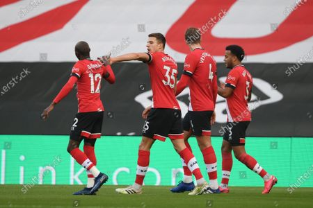 Jan Bednarek (2-L) of Southampton celebrates with teammates after scoring the 1-0 lead during the English Premier League soccer match between Southampton FC and Manchester United in Southampton, Britain, 29 November 2020.